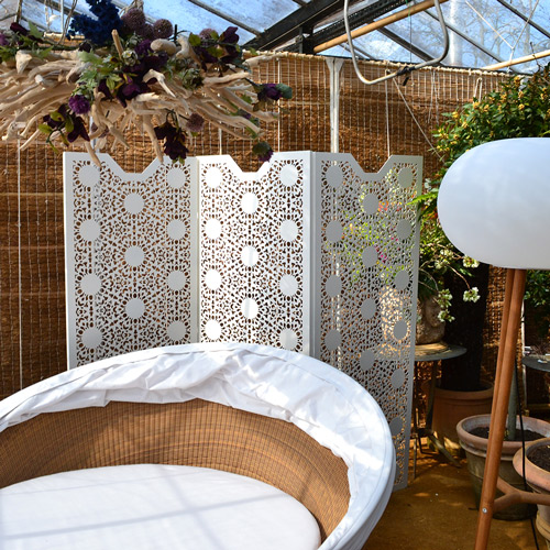 Perforated-laser-cut-metal-screens-and room dividers in-nottingham-lace-pattern-in-garden-setting